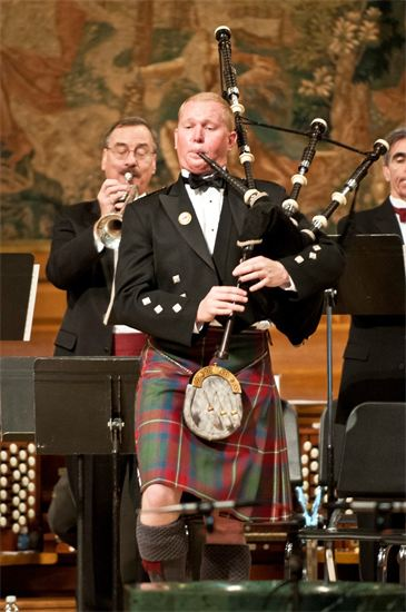 Pipe Major Scott Larson performs at the 2012 edition of the Pipes of Christmas